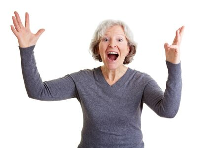 Happy old senior woman cheering with her hands in the air Stock Photo - 9108874