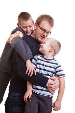 Happy father roughhousing with his two sons Stock Photo - 9185907