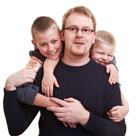 single man: Father gets hugged by his two smiling sons