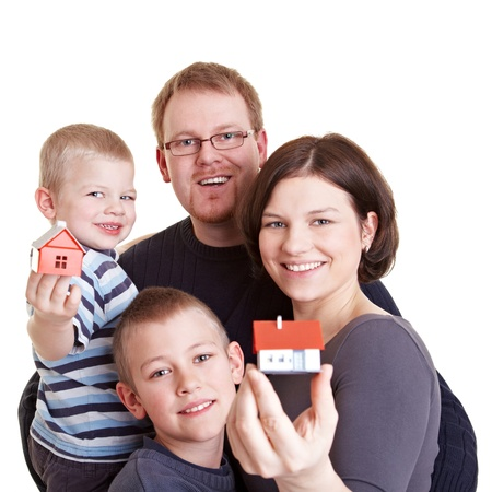 Happy family with two children holding small houses Stock Photo - 9185813