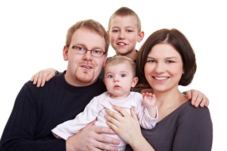 Portrait of a happy family with father and mother and child and a baby Stock Photo - 9185901
