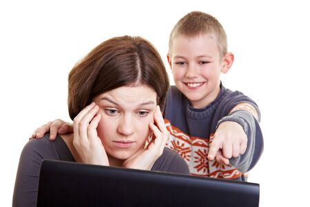 Son helping his mother with her computer problems Stock Photo - 9185892