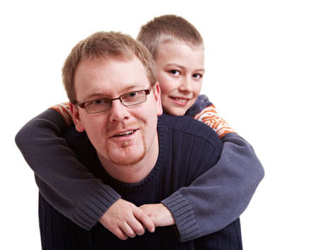romp: Father giving his happy son a piggyback ride