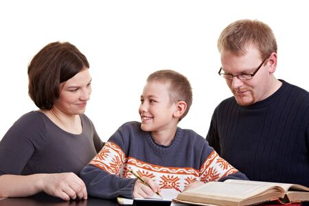 Father and mother helping son who is doing his homework photo