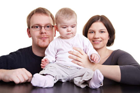 Portrait of family with father and mother and a baby girl Stock Photo - 9244028