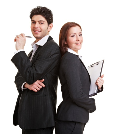 Two young business consultants leaning back to back photo