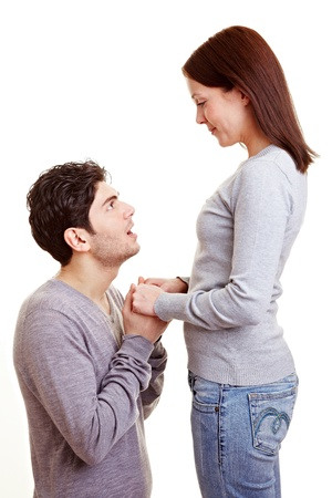 apology: Man apologizing on his knees to his girlfriend after a conflict Stock Photo