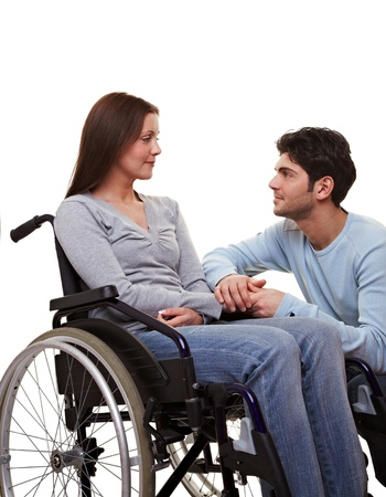 mobility nursing: Man comforting a young woman in a wheelchair