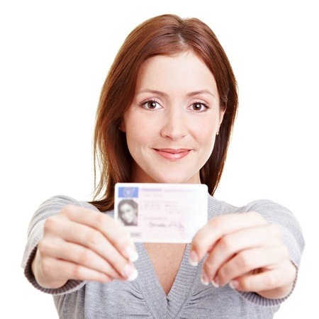 driving school: Happy young teenage girl with a European driving license from Germany