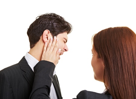 harass: Woman slaping businessman in the face after sexual harrasment