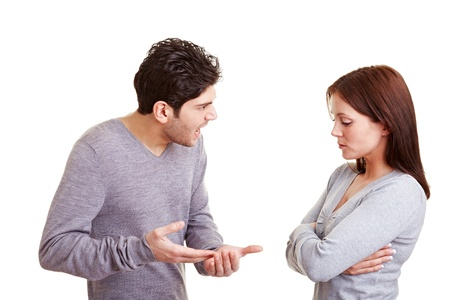 choleric: Angry man screaming insults at his girlfriend Stock Photo