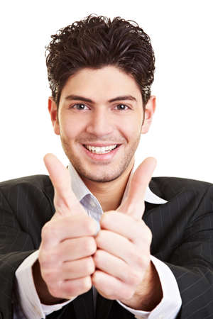 Happy smiling college ctudent holding both thumbs up photo
