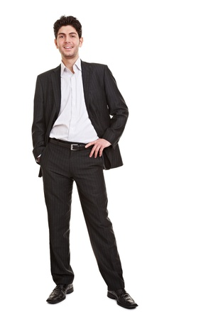 Full body shot of a young relaxed smiling manager standing Stock Photo - 9324557