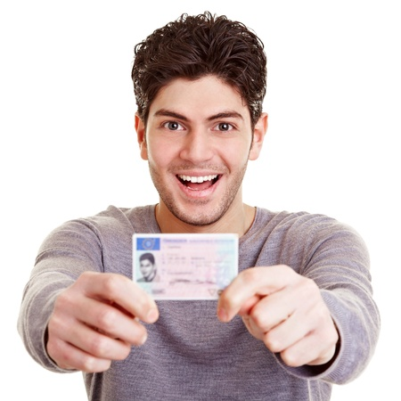 driving: Young proud man with his European driving license Stock Photo