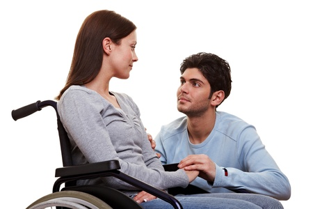 paralyzed: Young man caring for his disabled girlfriend in wheelchair