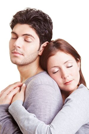 Happy woman leaning on to her boyfriend from behind