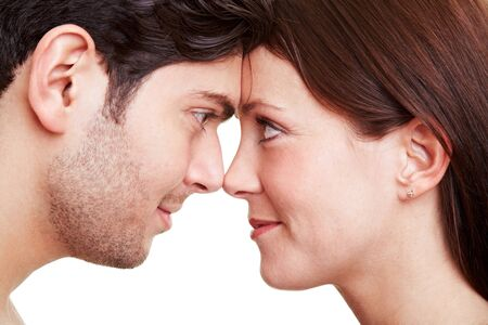 Happy couple in love looking deeply into each others eyes photo
