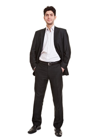 frontal: Full body shot of attractive young manager standing in a suit