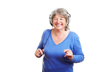 cutout old people: Happy elderly woman with headphones dancing to music