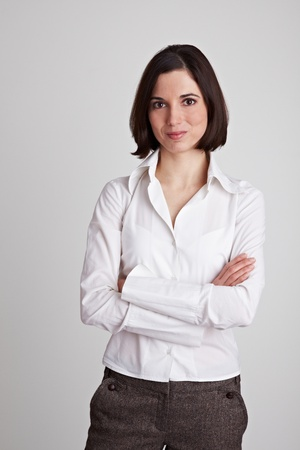 Young content business woman with her arms crossed photo