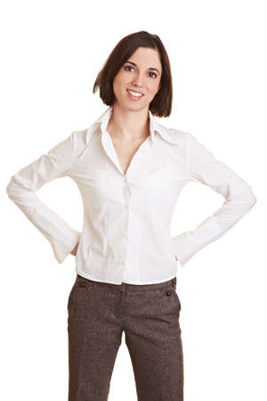 Smiling young business woman with her arms akimbo photo