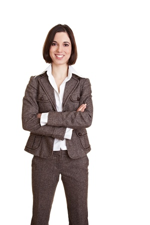 frontal portrait: Young happy business woman with her arms crossed