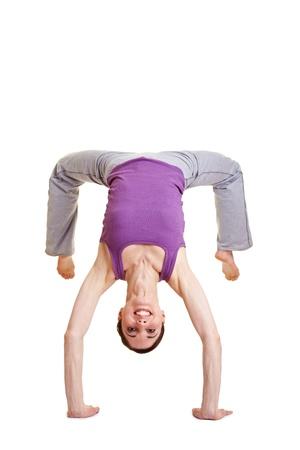BACKFLIP: Happy flexible woman doing a somersault backflip Stock Photo
