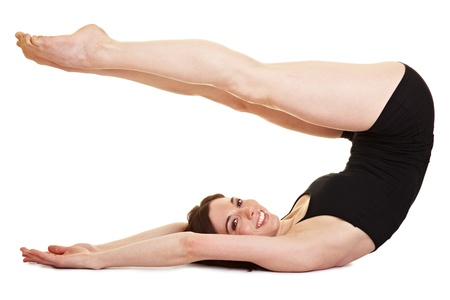 pilates studio: Young woman stretching her legs as a fitness exercise Stock Photo