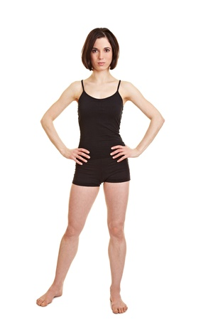 frontal: Full body shot of slim sportive woman with her arms akimbo Stock Photo