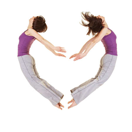 Jumping young woman forming a heart shape Stock Photo - 9436800