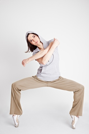 Cool female hiphop dancer and breakdancer standing on toptoes photo