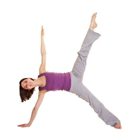 Young smiling flexible woman stretching her legs photo