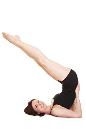 Flexible woman doing back exercises in shoulder stand photo