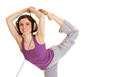 Flexible woman listening to music with headphone Stock Photo - 9515600