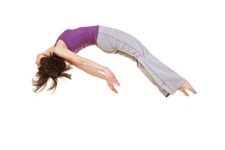 backflip: Young flexible woman doing a somersault backflip