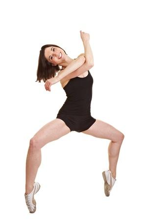 on tiptoes: Young smiling dancing ballerina standing on tiptoes