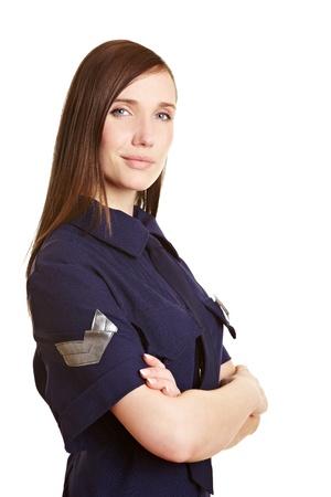 sicurezza sul lavoro: Donna poliziotto giovane sorridente con le braccia incrociate