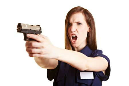 officers: Police woman screaming a warning before firing her weapon Stock Photo
