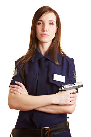 Young police woman with her service weapon photo
