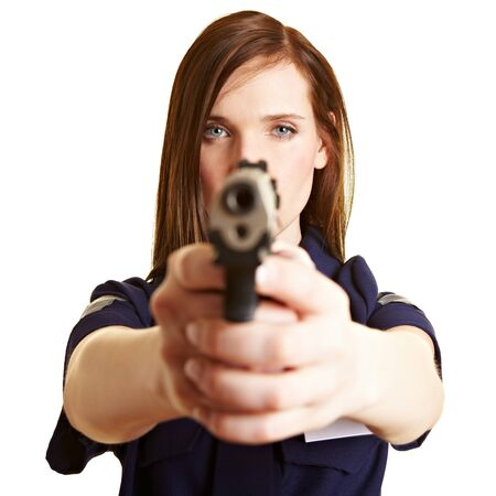 use pistol: Female police officer aiming with service weapon