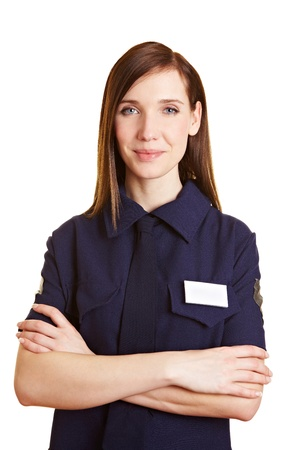 sicurezza sul lavoro: Ritratto di un giovane poliziotto femmina con le braccia incrociate