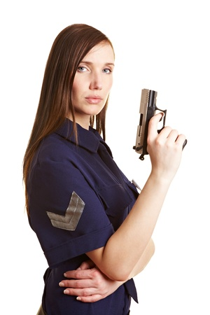 Young female police officer with a pistol in her hand Stock Photo - 9524460