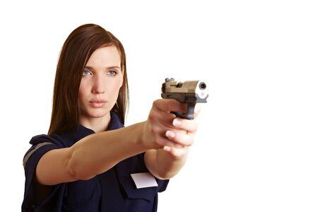 mujer policia: Oficial de mujeres policer con el objetivo de su arma de servicio