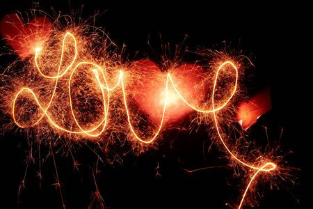 Writing the word love with sparkling light photo