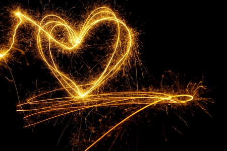 Background made of a burning heart painted with sparkling light Stock Photo