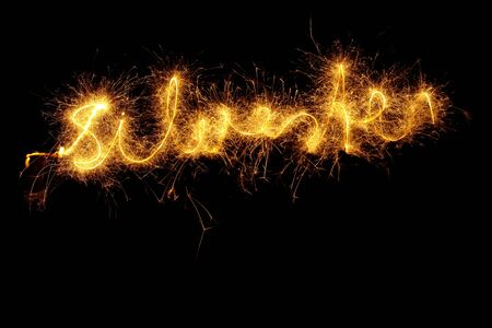 Sparkler at night light writing the word