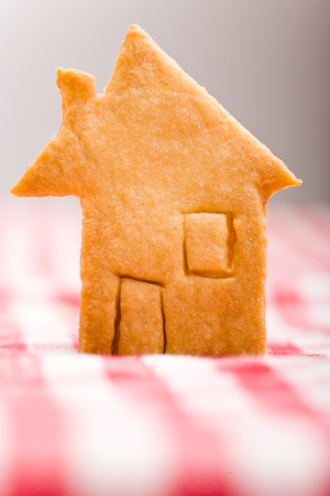 House shaped christmas cookie on striped tablecloth photo
