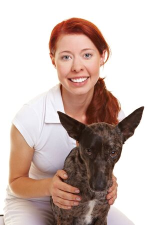 assistent: Attractive smiling woman with her crossbreed dog Stock Photo