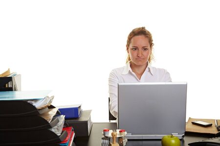 Business woman working on a laptop at her desk Stock Photo - 10174940