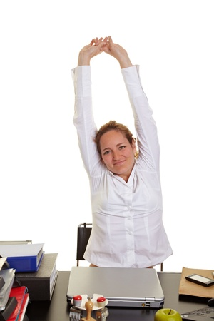 Happy business woman doing some back exercises at work photo